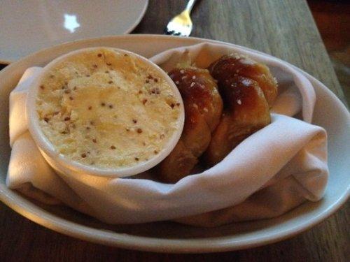 warm pretzel rolls with mustard butter